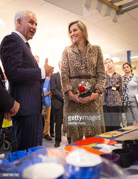 Henri Koerhuis and Queen Maxima of The Netherlands visit the social employment agency Breed on October 7, 2014 in Nijmegen The Netherlands.
