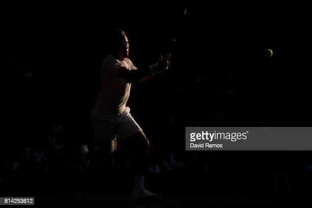 Henri Kontinen of Findland plays a forehand during the Mixed Doubles quarter final match against Rohan Bopanna of India and Gabriela Dabrowski of...
