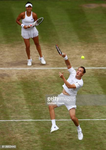 Henri Kontinen of Finland and Heather Watson of Great Britain in action in the Mixed Doubles quarter final match against Rohan Bopanna of India and...