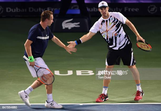 Henri Kontinen of Finland and John Peers of Australia icelebrate a point during their semi final doubles match against JeanJulien Rojer of...