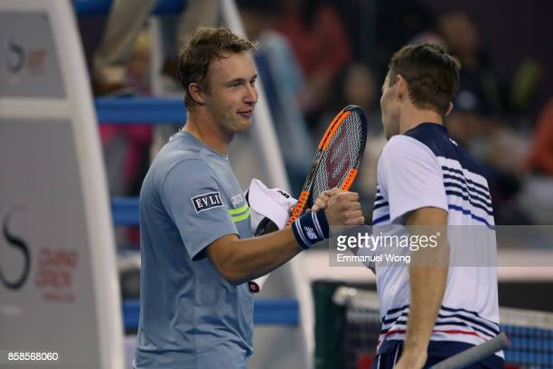 Henri Kontinen of Finland and John Peers of Australia celebrate after winning their Men's double semi finals match against Paolo Lorenzi of Italy and...