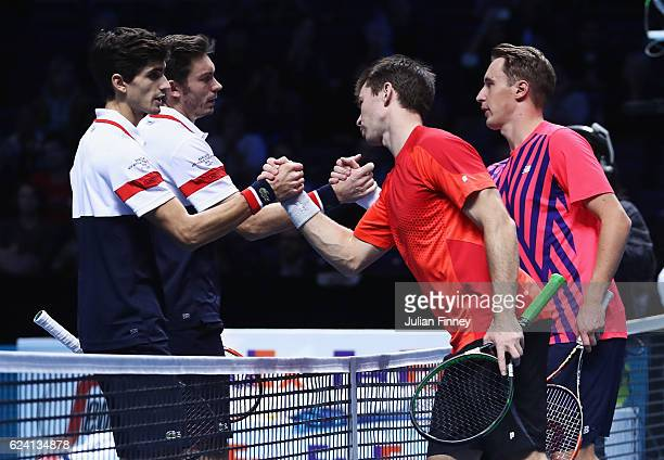 Henri Kontinen of Finland and John Peers of Australia celebrate victory in their men's doubles match against Nicolas Mahut and PierreHugues Herbert...