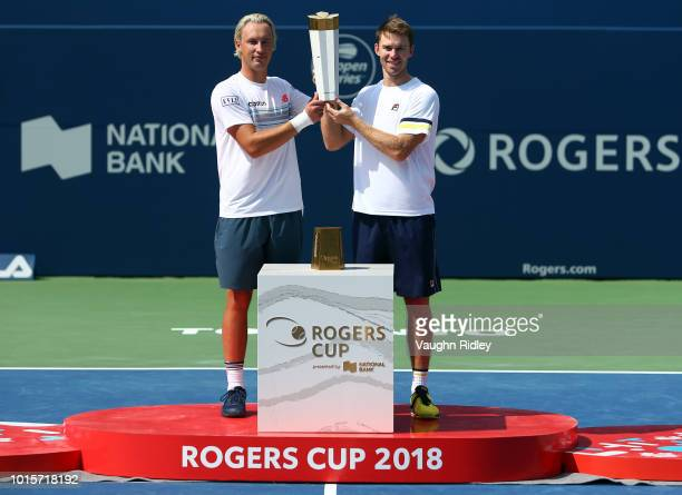 Henri Kontinen of Finland and John Peers of Australia celebrate victory following the doubles final match against Raven Klaasen of South Africa and...