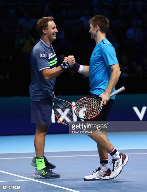 Henri Kontinen of Finland and John Peers of Australia celebrate victory during the doubles match against JeanJulien Rojer of The Netherlands and...