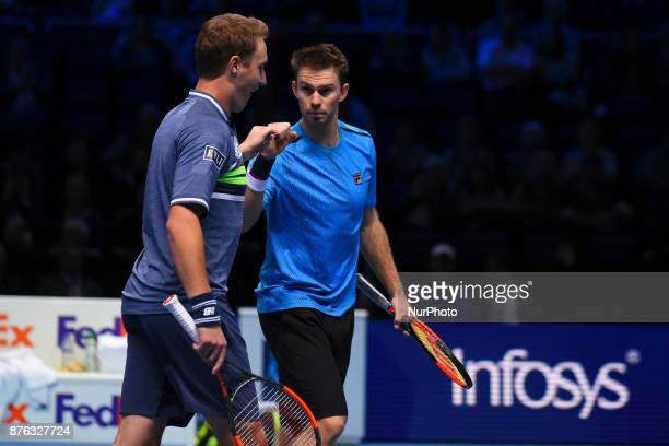 Henri Kontinen of Finland and John Peers of Australia celebrate victory following the doubles final against Marcelo Melo of Brazil nd Lukasz Kubot of...