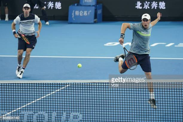 Henri Kontinen of Finland and John Peers of Australia compete during the Men's doubles final match against Jack Sock and John Isner of the United...