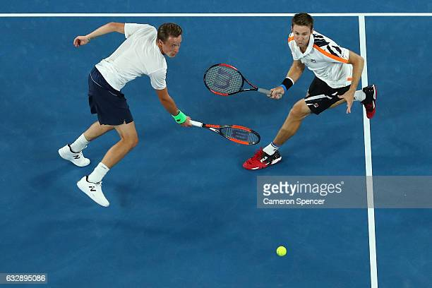 Henri Kontinen of Finland and John Peers of Australia compete in their Men's Doubles Final against Bob Bryan of the United States and Mike Bryan of...