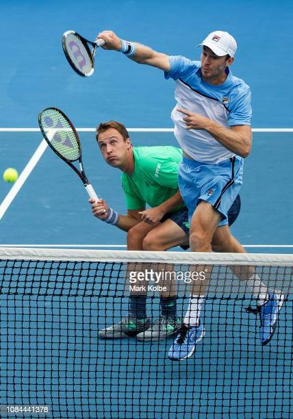 Henri Kontinen of Finland and John Peers of Australia during their second round match against Neal Skupski of Great Britain and Ken Skupski of Great...