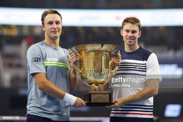 Henri Kontinen of Finland and John Peers of Australia hold the winners trophy after winning the Mens's doubles final against Jack Sock and John Isner...