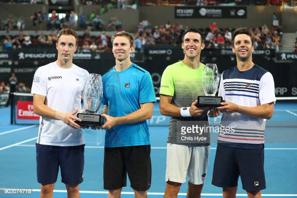 Henri Kontinen of Finland and John Peers of Australia hold the winnings trophy after the Men's doubles final against Leonardo Mayers and Horacio...