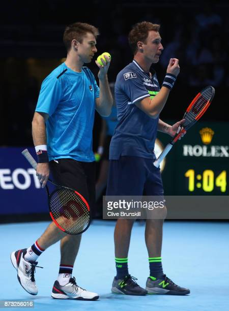Henri Kontinen of Finland and John Peers of Australia in action during their straight sets defeat against Michael Venus of New Zealand and Ryan...