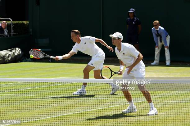 Henri Kontinen of Finland and John Peers of Australia in action during the Gentlemen's Doubles third round match against Hugo Nys of France and...