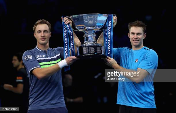 Henri Kontinen of Finland and John Peers of Australia lift the trophy following victory following the doubles final against Marcelo Melo of Brazil nd...