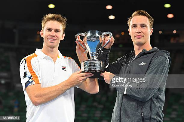 Henri Kontinen of Finland and John Peers of Australia pose with the championship trophy after winning the Men's Doubles Final against Bob Bryan of...