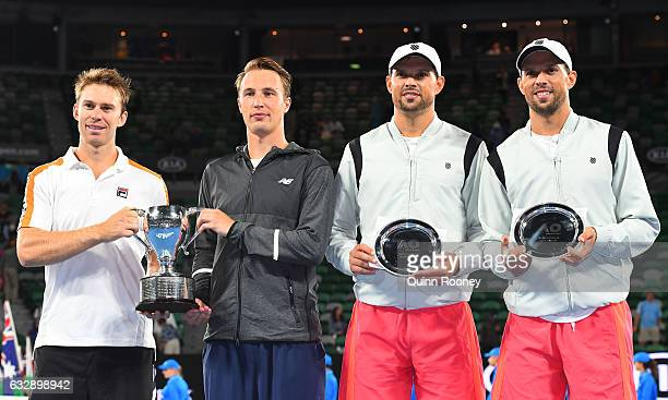 Henri Kontinen of Finland and John Peers of Australia pose with the winners trophy and Bob Bryan of the United States and Mike Bryan of the United...