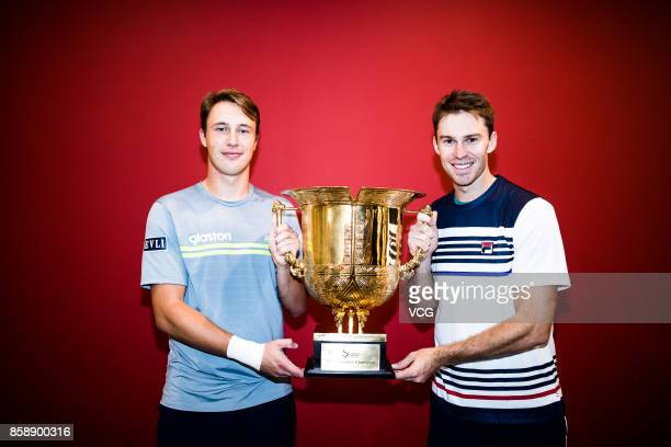 Henri Kontinen of Finland and John Peers of Australia pose with the trophy after winning the Men's doubles final match against Jack Sock and John...