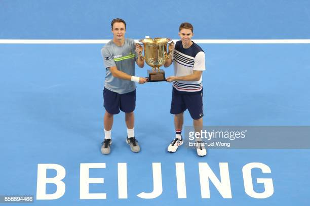 Henri Kontinen of Finland and John Peers of Australia pose with their trophy after winning the Men's doubles final match against Jack Sock and John...