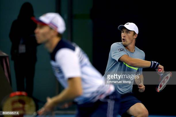 Henri Kontinen of Finland and John Peers of Australia return a shot during their Men's double semi finals match against Paolo Lorenzi of Italy and...