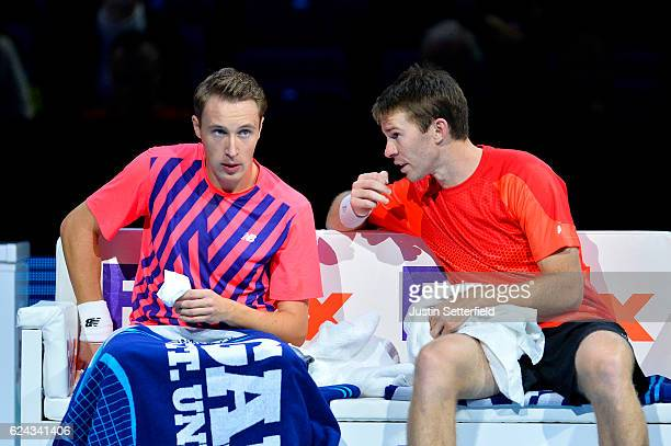 Henri Kontinen of Finland and John Peers of Australia talk tactics during a break in their men's doubles semifinal match against Mike Bryan of the...