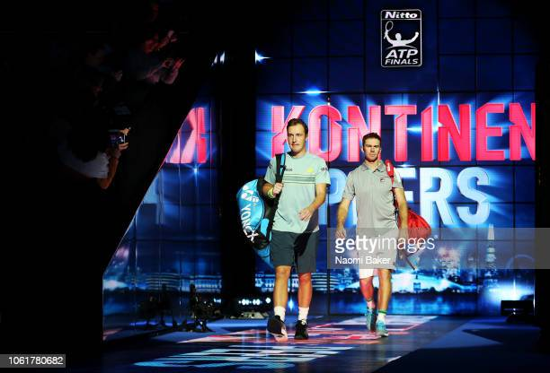 Henri Kontinen of Finland and John Peers of Australia walk onto the court ahead of their match against Jamie Murray of Great Britain and Bruno Soares...