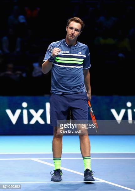 Henri Kontinen of Finland partner of John Peers of Australia celebrates during the doubles match against JeanJulien Rojer of The Netherlands and...