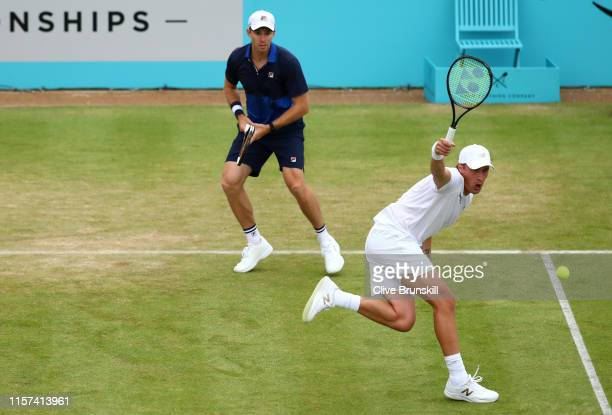 Henri Kontinen of Finland partner of John Peers of Australia plays a backhand during his QuarterFinal Doubles Match against Jamie Murray and Neal...