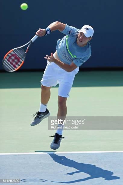 Henri Kontinen of Finland returns a shot against William Blumberg and Spencer Papa of the United States during their first round Men's Doubles match...