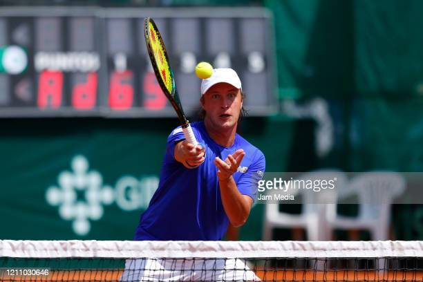 Henri Kontinen of Finland returns the ball during the third match as part of day 2 of Davis Cup World Group I Play-offs at Club Deportivo La Asuncion...