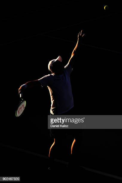 Henri Kontinen of Finland serves in his match with John Peers of Australia against Jamie Murray of Great Britain and Bruno Soares of Brazil during...
