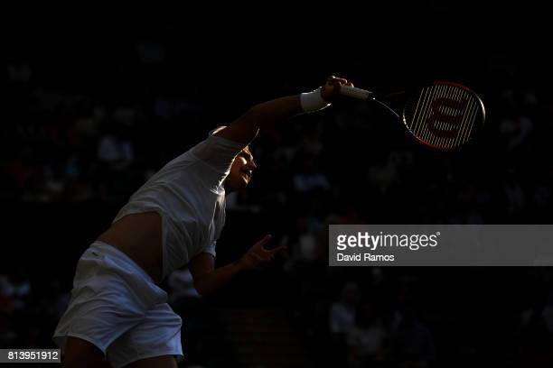 Henri Kontinen of Finland serves partnering Heather Watson of Great Britain in the Mixed Doubles quarter final match against Rohan Bopanna of India...