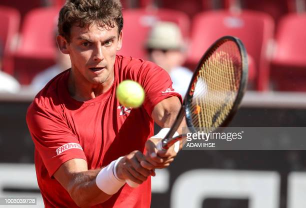 Henri Laaksonen of Switzerland returns a ball to Richard Gasquet of France during their semifinal match at the Swedish Open tennis tournament in...