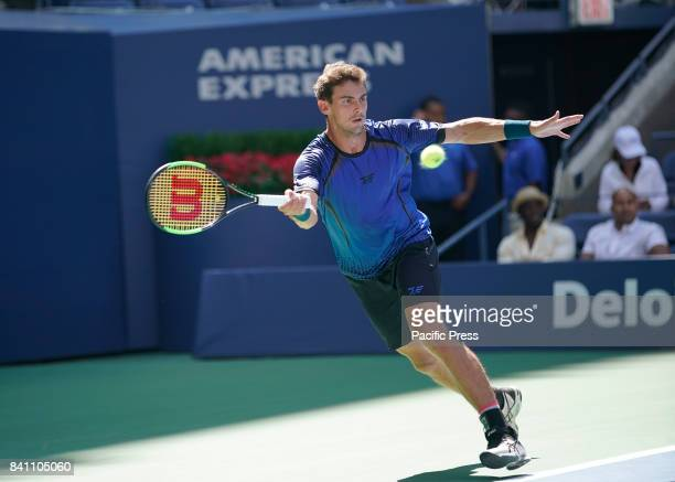 Henri Laaksonen of Switzerland returns ball during match against Juan Martin del Potro of Argentina at US Open Championships at Billie Jean King...