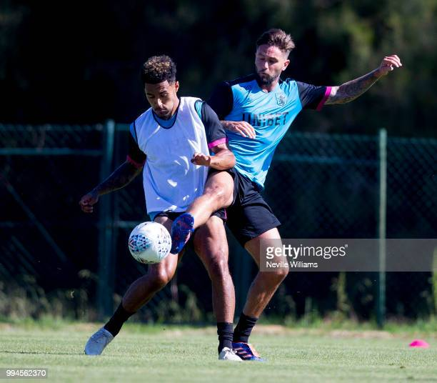 Henri Lansbury of Aston Villa in action with team mate Andre Green during an Aston Villa training session at the club's training camp on July 09 2018...