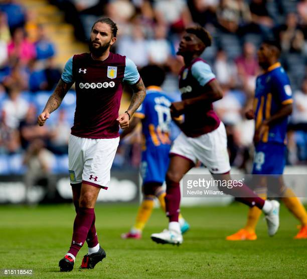 Henri Lansbury of Aston Villa scores a penalty during the PreSeason Friendly match between Shrewsbury Town and Aston Villa at the Greenhous Meadow on...