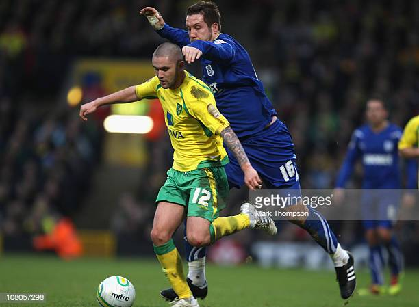 Henri Lansbury of Norwich City battes with Jon Parkin of Cardiff City during the npower Championship match between Norwich City and Cardiff City at...