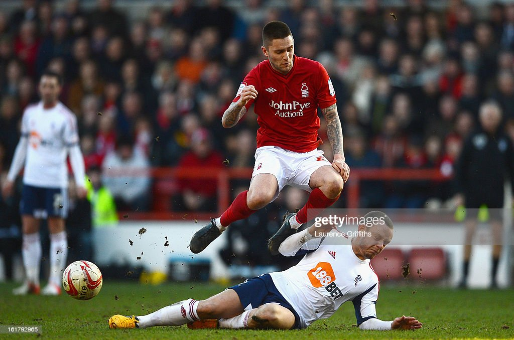 Henri Lansbury of Nottingham Forest battles with Jay Spearing of Bolton Wanderers during the npower Championship match between Nottingham Forest and Bolton Wanderers at City Ground on February 16, 2013 in Nottingham, England.