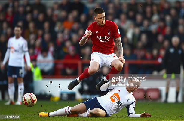 Henri Lansbury of Nottingham Forest battles with Jay Spearing of Bolton Wanderers during the npower Championship match between Nottingham Forest and...