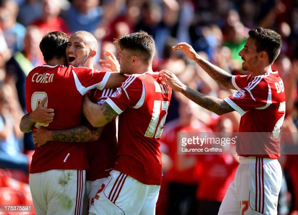 Henri Lansbury of Nottingham Forest celebrates scoring the opening goal during the Sky Bet Championship match between Nottingham Forest and...