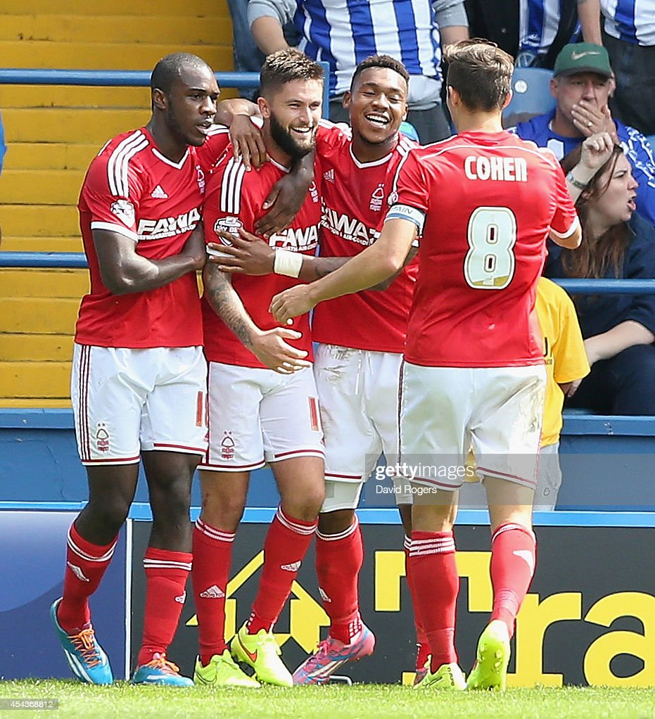 Henri Lansbury (2nd L) of Nottingham Forest celebrates with team mates after scoring the opening goal during the Sky Bet Championship match between Sheffield Wednesday and Nottingham Forest at Hillsborough Stadium on August 30, 2014 in Sheffield, England.