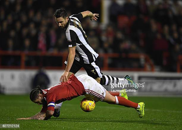Henri Lansbury of Nottingham Forest is fouled by Paul Dummett of Newcastle United to give away a penalty during the Sky Bet Championship match...