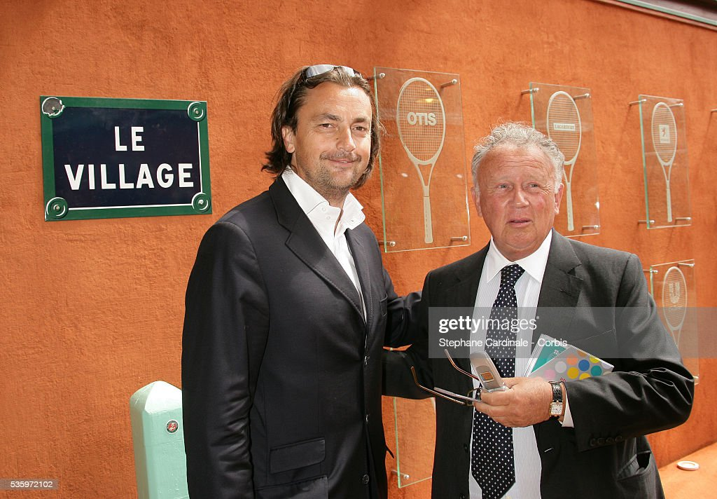 Henri Lecomte and Philippe Bouvard visit the Roland Garros village during the 2005 French Open Tennis.