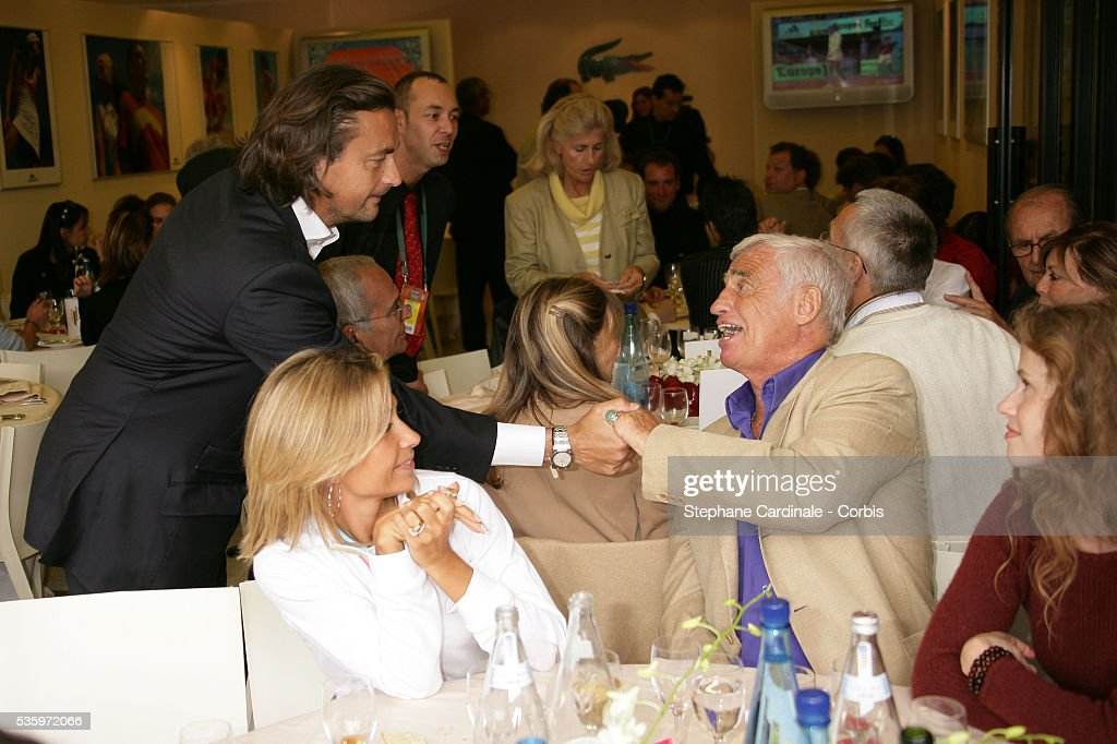 Henri Lecomte, Jean-Paul Belmondo with his wife, Natty visit the Roland Garros village during the 2005 French Open Tennis.