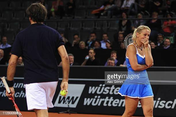 Henri Leconte and Barbara Rittner play a show match against Sabine Lisicki and Carl-Uwe Steeb during the Porsche Tennis Grand Prix at Porsche Arena...
