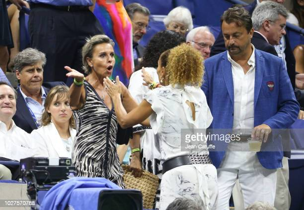 Henri Leconte and girlfriend Maria Dowlatshahi attend day 10 of the 2018 tennis US Open on Arthur Ashe stadium at the USTA Billie Jean King National...