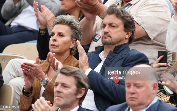 Henri Leconte and his girlfriend Maria Dowlatshahi attend day 5 of the 2019 French Open at Roland Garros stadium on May 30 2019 in Paris France