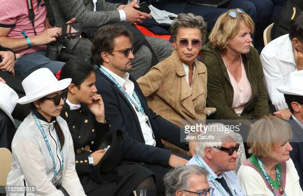 Henri Leconte and his girlfriend Maria Dowlatshahi during day 4 of the 2019 French Open at Roland Garros stadium on May 29 2019 in Paris France