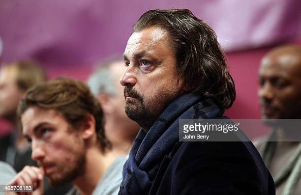 Henri Leconte and his son Maxime Leconte look on during the Amelie Mauresmo Tennis Night to benefit the 'Institut Curie' to fight cancer during the...