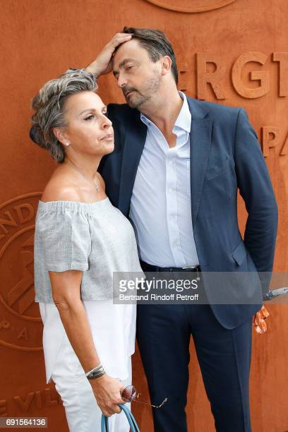 Henri Leconte and his wife Maria Dowlatshahi attend the 2017 French Tennis Open Day Six at Roland Garros at Roland Garros on June 2 2017 in Paris...