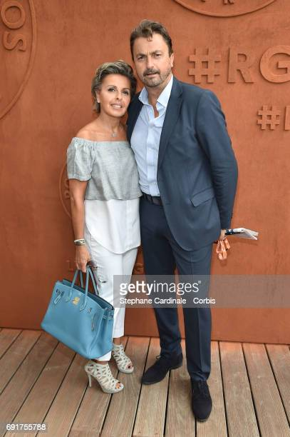 Henri Leconte and his wife Maria Dowlatshahi attend the 2017 French Tennis Open Day Six at Roland Garros on June 2 2017 in Paris France