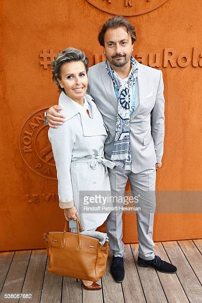 Henri Leconte and his wife Maria Dowlatshahi attend the French Tennis Open Day Fourteen at Roland Garros on June 4 2016 in Paris France